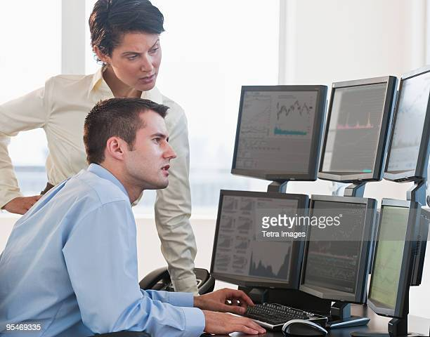 Traders studying computer screens