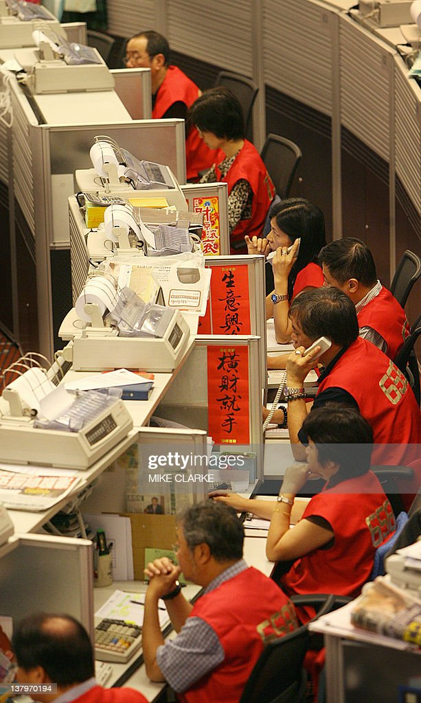 Traders take orders at the Stock Exchange of Hong Kong 10 October 2006 Hong Kong share prices closed 031 percent lower as investors locked in profits...