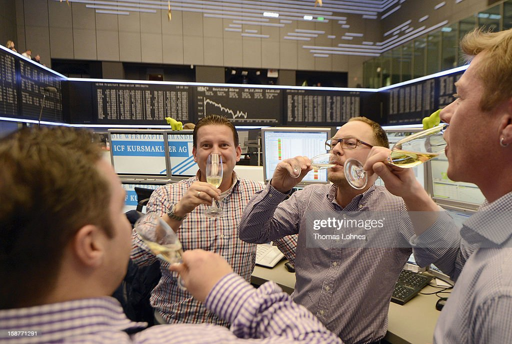 Traders toast one another with champagne on the last day of trading for 2012 at the Frankfurt Stock Exchange on December 28, 2012 in Frankfurt, Germany. The DAX index of Germany's largest corporations finished the year at over 7,500, which represents a strong increase for the year. At the same time one year ago the index stood at just under 6,000.