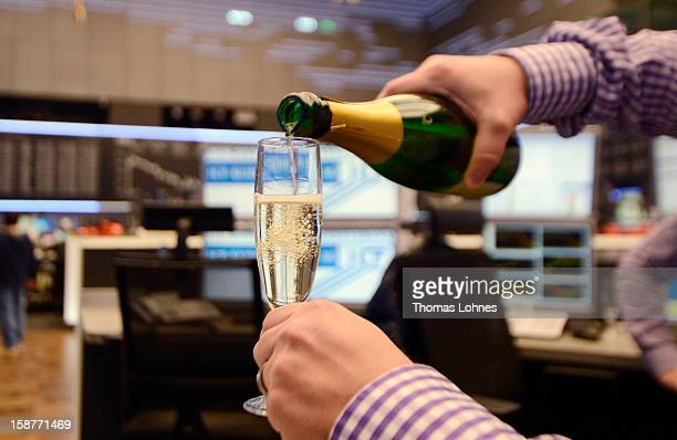 Traders toast one another with champagne on the last day of trading for 2012 at the Frankfurt Stock Exchange on December 28 2012 in Frankfurt Germany...