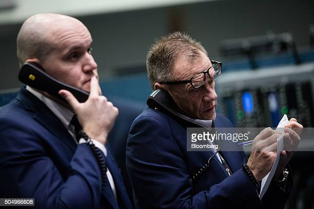 Traders use fixed line telephones as they work from the trading floor of the open outcry pit at the London Metal Exchange in London UK on Thursday...