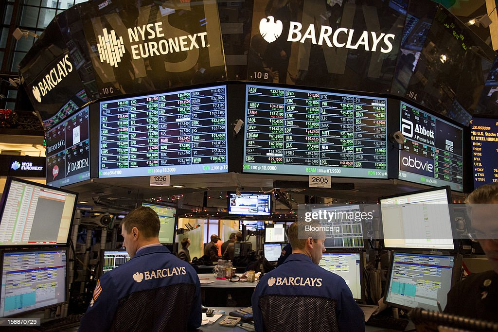 Traders view monitors while working at the Barclays PLC booth on the floor of the New York Stock Exchange (NYSE) in New York, U.S., on Wednesday, Jan. 2, 2013. U.S. stocks rose, after the largest year-end rally for the Standard & Poor's 500 Index since 1974, as lawmakers passed a bill averting spending cuts and tax increases threatening a recovery in the world's biggest economy. Photographer: Scott Eells/Bloomberg via Getty Images