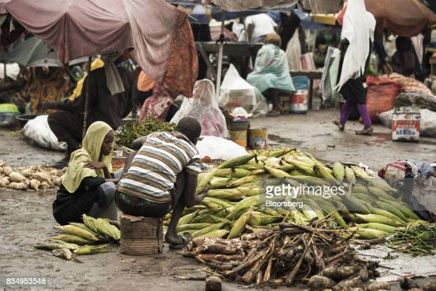 Traders wait for customers for their corn cobs at an outdoor food market in N'Djamena Chad on Tuesday Aug 15 2017 African Development Bank and...