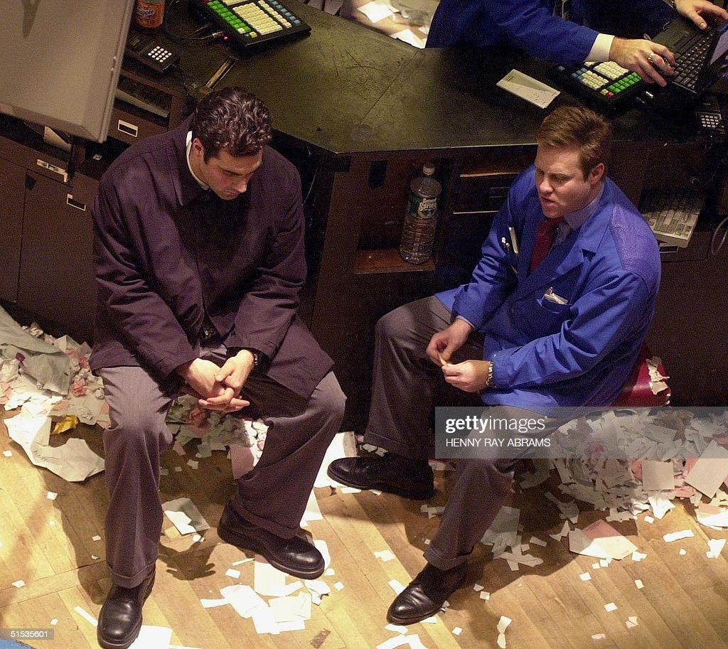 Traders wait on the floor of the New York Stock Exchange after the close of trading 04 January 2000 The Dow Jones closed down 35586 points and the...