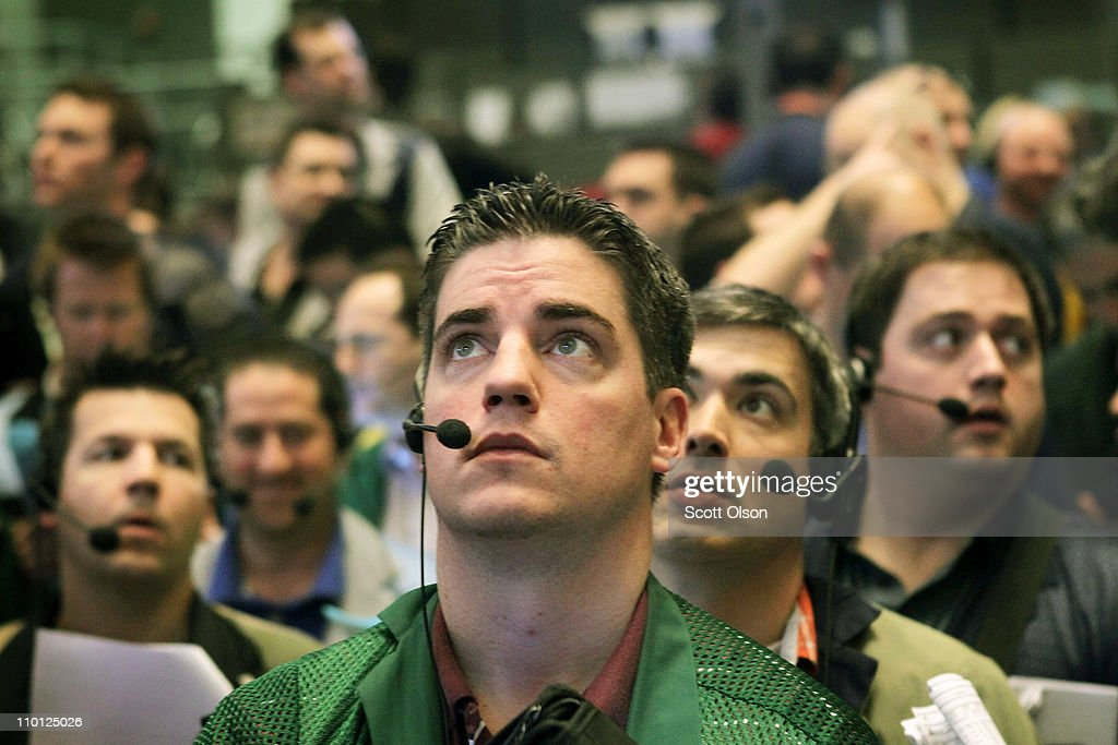 Traders watch prices in the Ten-Year Treasury Note options pit at the CME Group following the announcement by the Federal Open Market Committee (FOMC) that they would maintain the key policy rate near zero on March 15, 2011 in Chicago, Illinois. U.S. stock and commodity prices tumbled today following a sharp drop in Japan's stock market, as investors worldwide worry about the economic impact of that country's recent earthquake, tsunami and unfolding nuclear crisis.