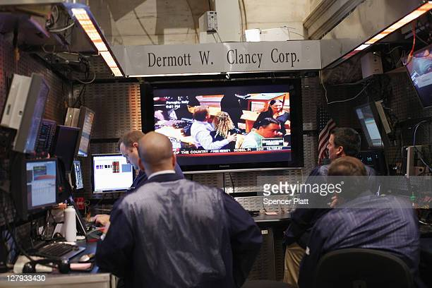 Traders watch the conclusion of the Amanda Knox trial on the floor of the New York Stock Exchange at the end of the trading day on October 3 2011 in...