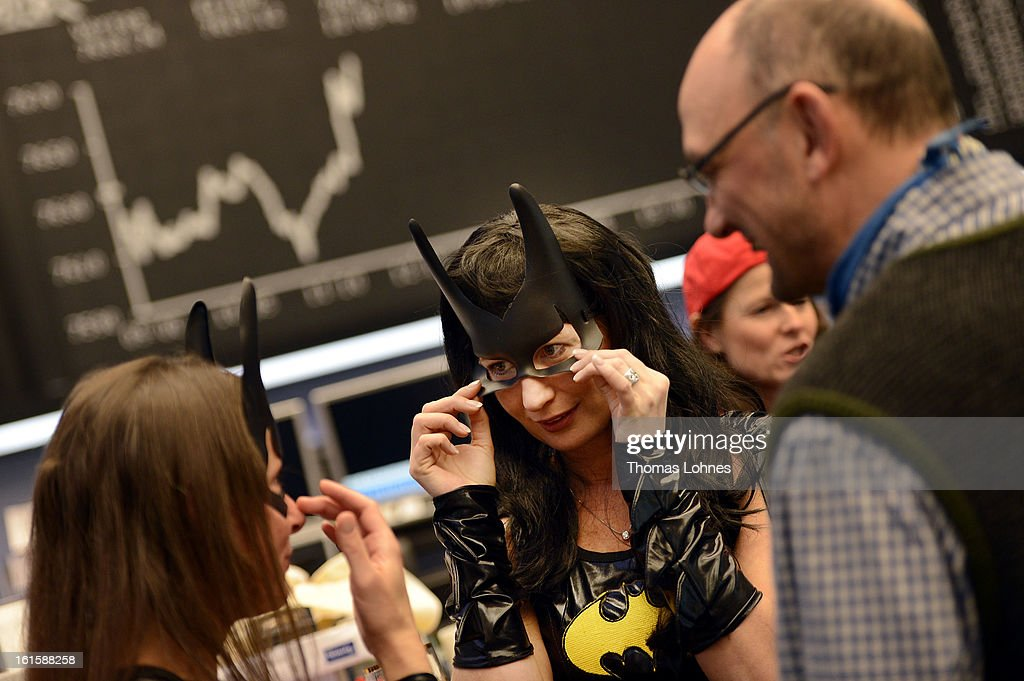Traders wear Batwoman costumes at work on the trading floor of the Frankfurt Stock Exchange on February 12, 2013 in Frankfurt am Main, Germany. Carnival has been an annual tradition in parts of western Germany since 1823 and workers often celebrate free-spirited merrymaking by wearing carnival fancy dress costumes before the beginning of Lent.