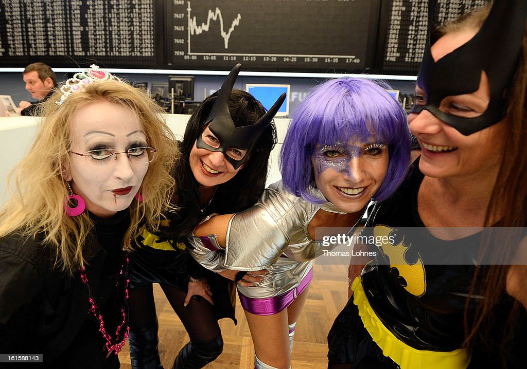 Traders wearing costumes pose on the trading floor of the Frankfurt Stock Exchange on February 12, 2013 in Frankfurt am Main, Germany. Carnival has been an annual tradition in parts of western Germany since 1823 and workers often celebrate free-spirited merrymaking by wearing carnival fancy dress costumes before the beginning of Lent.