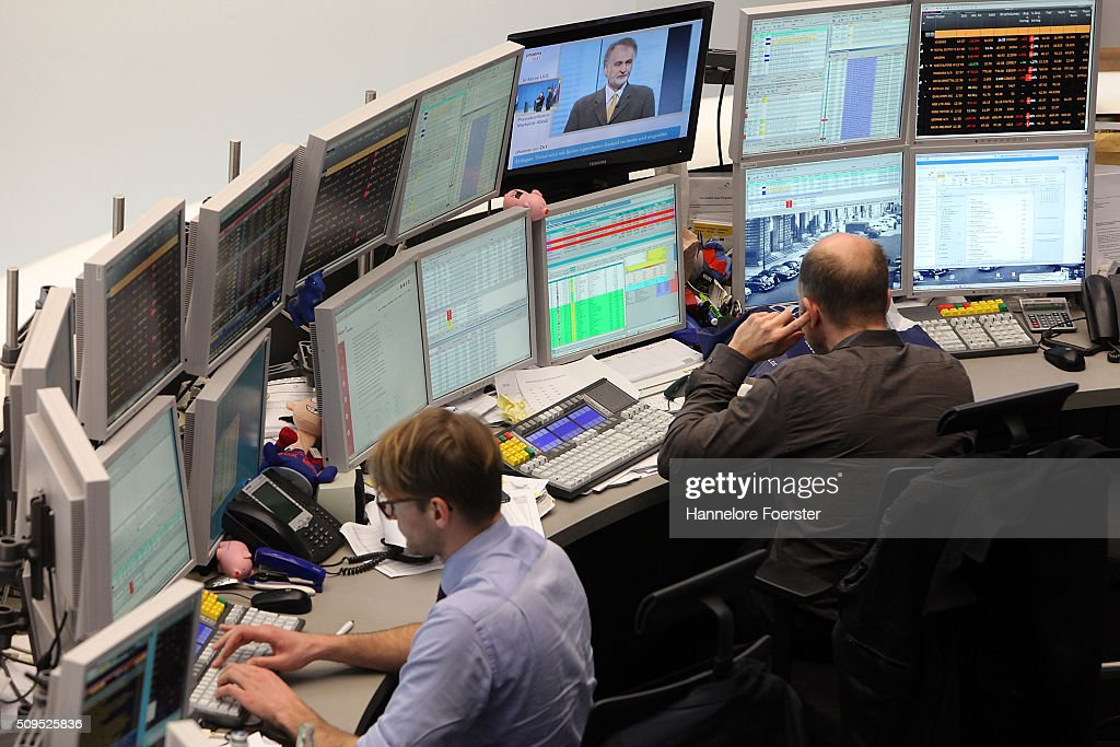Traders with his monitors at the Frankfurt Stock Exchange on February 11, 2016 in Frankfurt, Germany. Stock markets across the globe have been exceptionally volatile in recent weeks as investors fear a global economic slowdown.