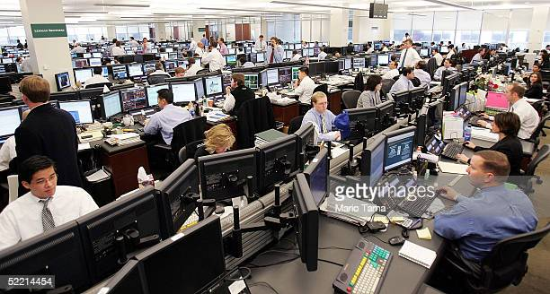 Traders work as US Treasury Secretary John Snow tours Lehman Brothers' trading floor February 18 2005 in New York City Snow is meeting with financial...