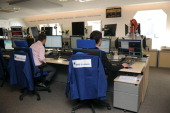 Traders work at a desk of the NYSE Euronext office in Paris on May 24 2011 NYSE Euronext is a EuroAmerican forprofit corporation that operates...