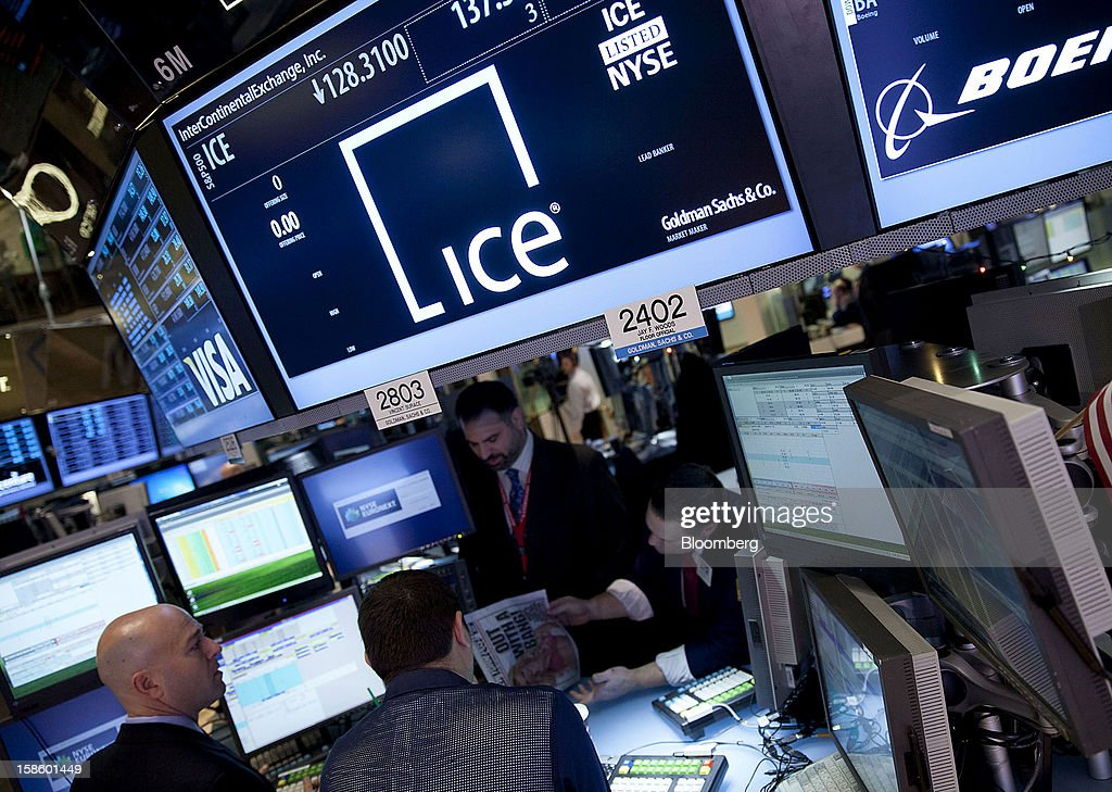 Traders work at the InterContinentalExchange Inc. (ICE) booth on the floor of the New York Stock Exchange (NYSE) in New York, U.S., on Thursday, Dec. 20, 2012. InterContinentalExchange Inc. (ICE), the 12-year-old energy and commodity futures bourse, agreed to acquire NYSE Euronext for cash and stock worth $8.2 billion, moving to take control of the world's biggest equities market. Photographer: Jin Lee/Bloomberg via Getty Images