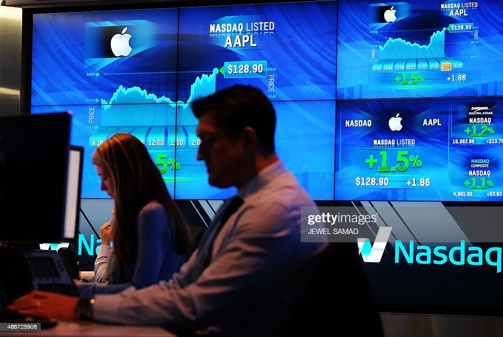 Traders work at the Nasdaq MarketSite in New York on March 18 2015 US stocks on March 18 finished mostly lower ahead of a closely watched Federal...