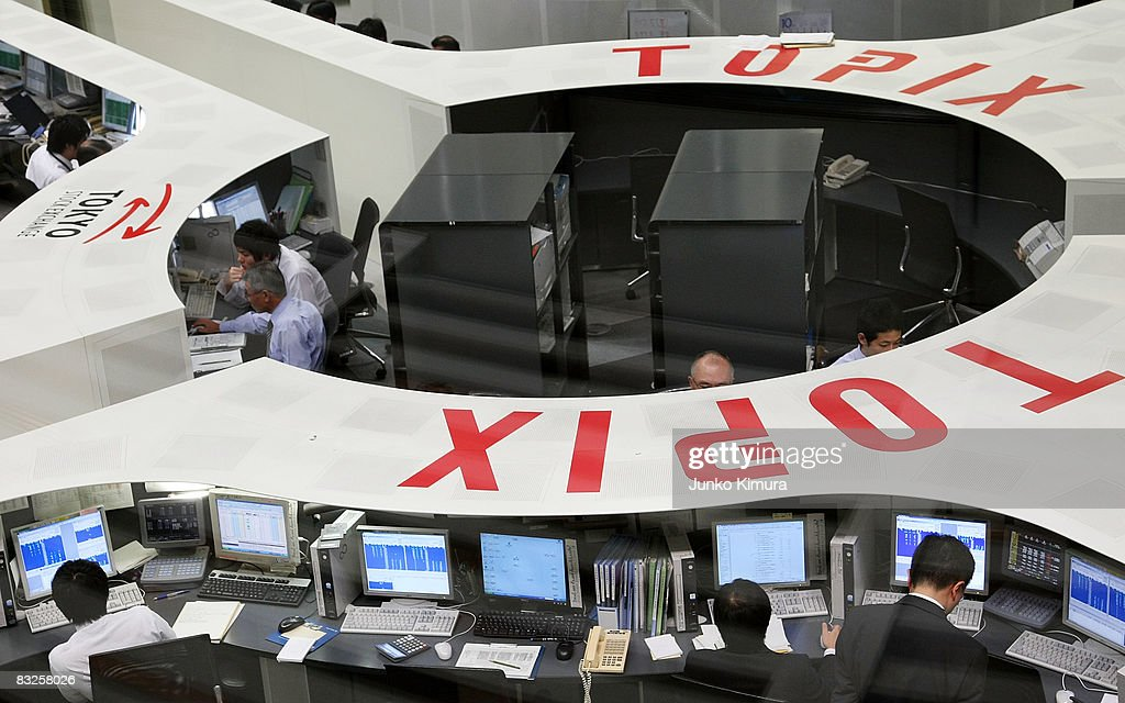 Traders work at Tokyo Stock Exchange on October 14 2008 in Tokyo Japan Nikkei 225issue index surge 13 percent regaining 9000yen level after G7...