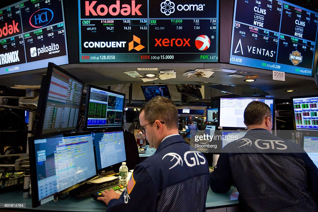 Traders Work Beneath Signage For Conduent Inc. And Xerox Corp. On The Floor  Of