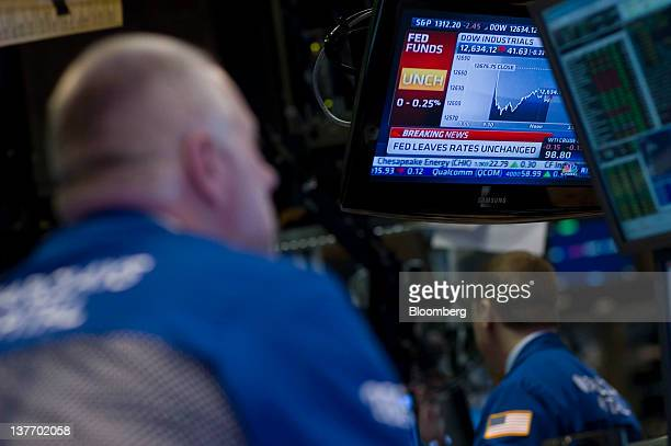 Traders work during the Federal Reserve Federal Open Market Committee rate decision on the floor of the New York Stock Exchange in New York US on...