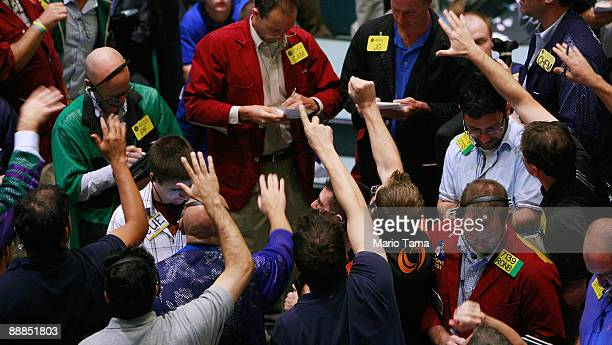 Traders work in the crude oil options pit at the New York Mercantile Exchange July 6 2009 in New York City The price of crude oil dropped to a...