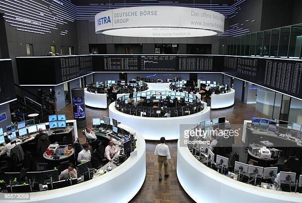 Traders work in the Frankfurt Stock Exchange in Frankfurt Germany on Monday Jan 4 2010 European stocks rose to a 15month high as Chinese...
