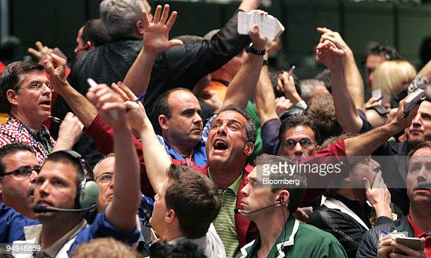 Traders work in the SP 500 pit at CME Group Inc's Chicago Board of Trade shortly after the Federal Open Market Committee's rate decision in Chicago...