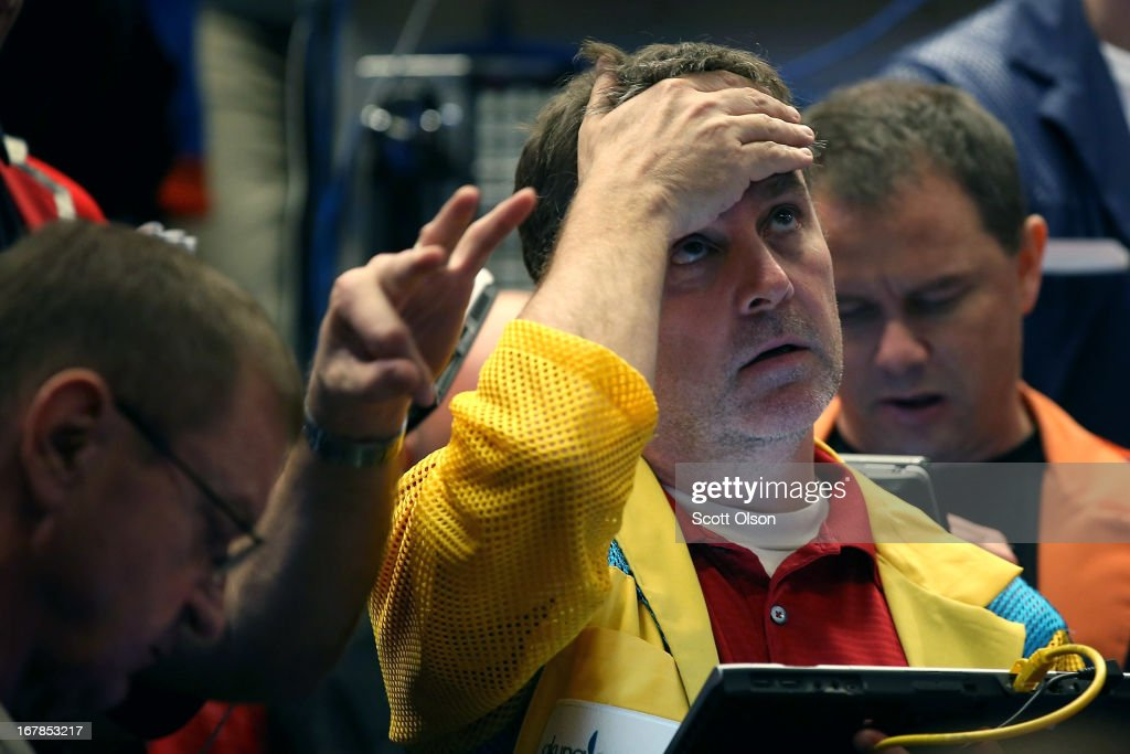 Traders work in the Standard & Poor's 500 stock index options pit at the Chicago Board Options Exchange (CBOE) prior to remarks from the Federal Reserve following the Feds two-day meeting of its policy-making committee on May 1, 2013 in Chicago, Illinois. Stating the economy was expanding at a 'moderate pace' and that the labor market had shown 'some improvement' the Federal Reserve said today that it would continue its stimulus campaign at the same pace it has maintained since December.