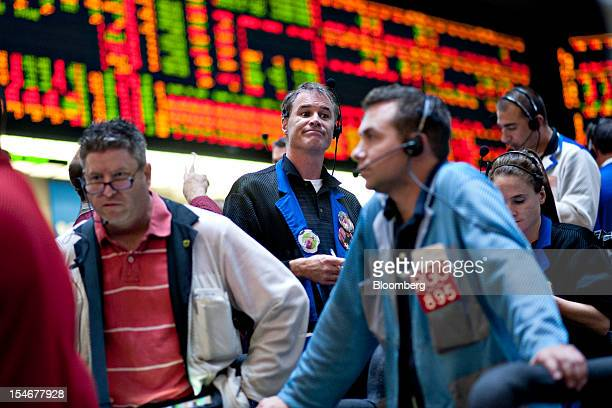Traders work in the tenyear US Treasury Note options pit at the Chicago Board of Trade in Chicago Illinois US on Wednesday Oct 24 2012 The Federal...