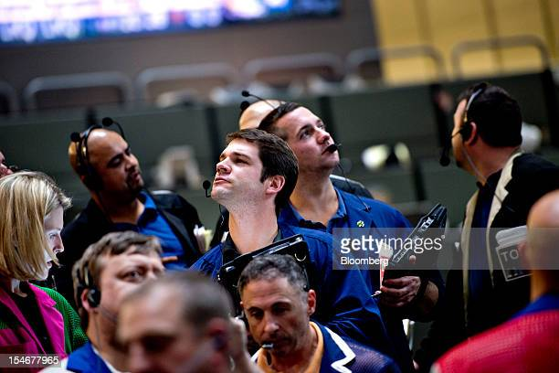 Traders work in the twoyear and fiveyear US Treasury Note options pit at the Chicago Board of Trade in Chicago Illinois US on Wednesday Oct 24 2012...