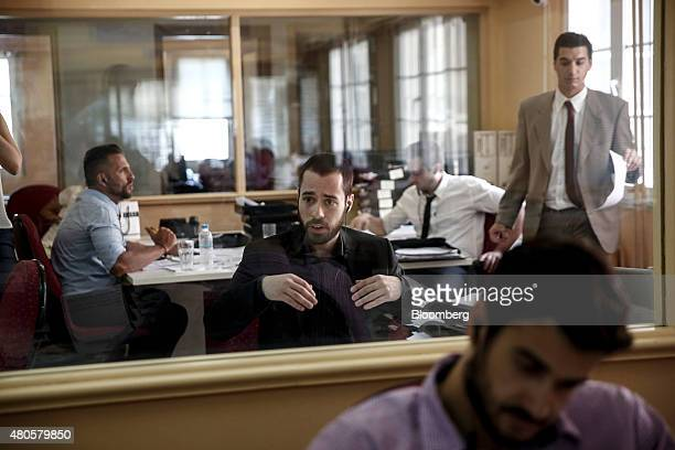 Traders work inside the offices of Nuntius Securities SA brokers in Athens Greece on Monday July 13 2015 Greece has been in financial limbo since the...