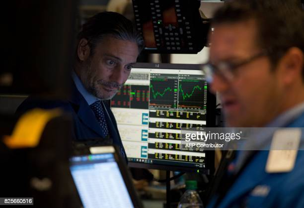 Traders work on the floor at the closing bell of the Dow Jones Industrial Average at the New York Stock Exchange on August 2 2017 in New York Wall...