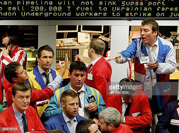 Traders work on the floor at the International Petroleum Exchange in London during trading 02 June 2004 Recordhigh oil prices and a panicky market...