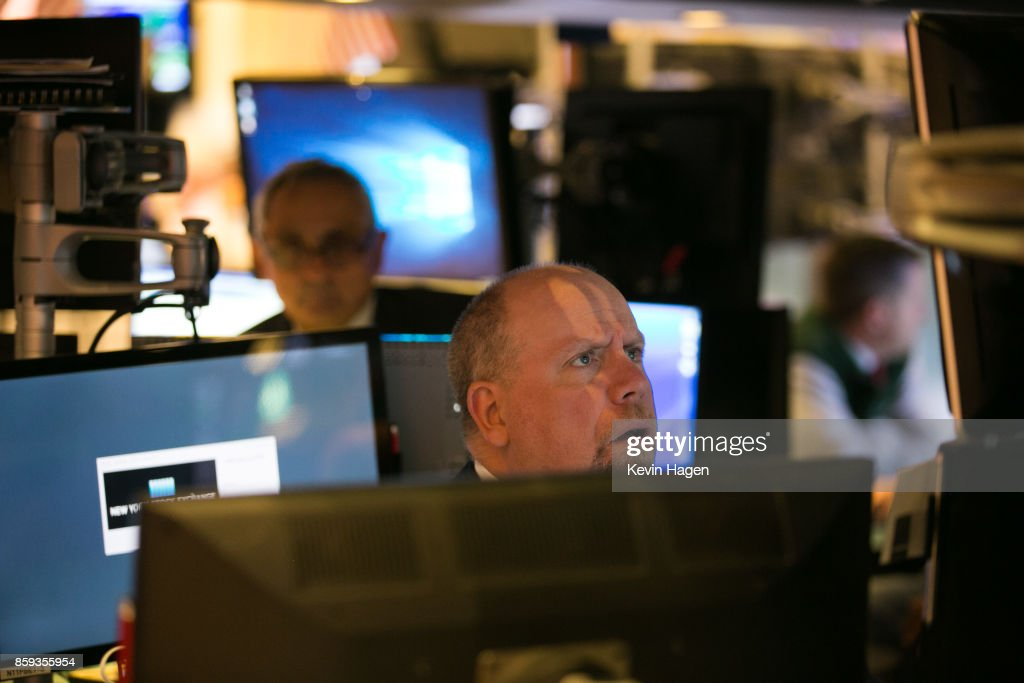 Traders work on the floor at the New York Stock Exchange on October 9, 2017 in New York City.