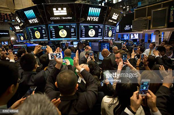 Traders work on the floor during the IPO of China Online Education Group at the New York Stock Exchange in New York US on Friday June 10 2016 US...