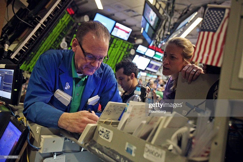 Traders work on the floor of the Chicago Board Options Exchange (CBOE) in Chicago, Illinois, U.S., on Thursday, April, 25, 2013. The CBOE opened for trading three-and-a-half hours late today after a software malfunction shut the derivatives market as its top executives were away at an industry event in Las Vegas. Photographer: Tim Boyle/Bloomberg via Getty Images