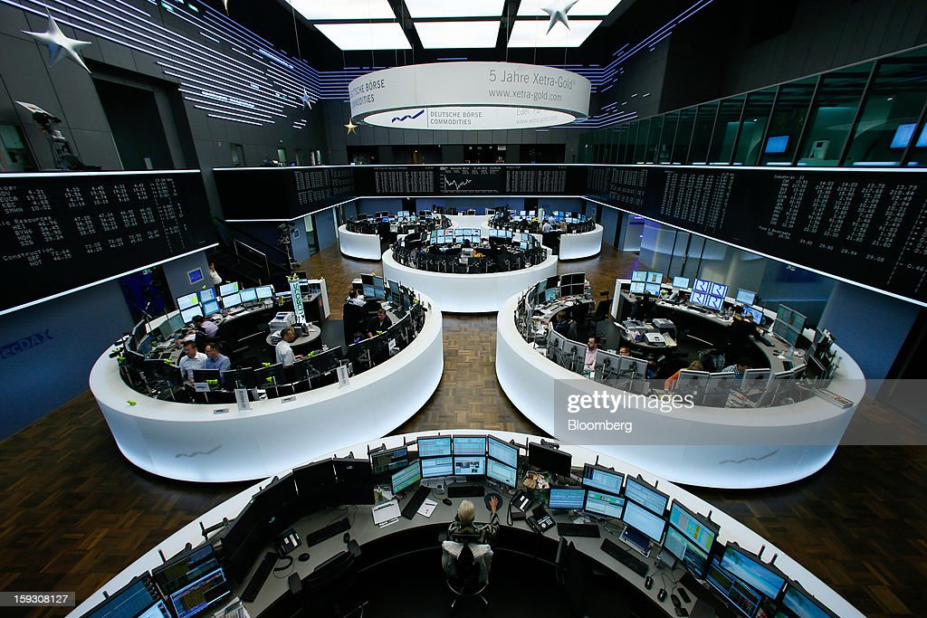 Traders work on the floor of the Frankfurt Stock Exchange in Frankfurt, Germany, on Friday, Jan. 11. 2013. European stocks pared their decline as Italy's borrowing costs dropped at a debt sale, offsetting concern that China has less room for monetary easing after a reported showed inflation increased more than estimated. Photographer: Ralph Orlowski/Bloomberg via Getty Images