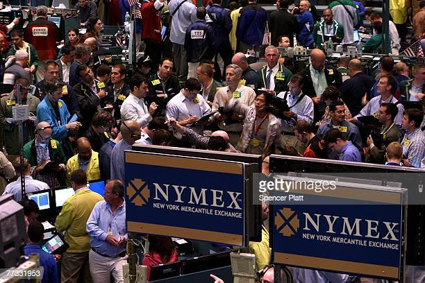 Traders work on the floor of the New York Mercantile Exchange October 15 2007 in New York City World oil prices rose Monday breaking 85 dollars per...