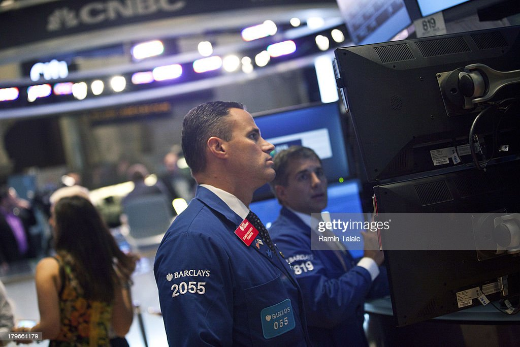 Traders work on the floor of the New York Stock Exchange (NYSE) after the opening bell on September 6, 2013 in New York City. A group of National Hokey League all stars rang the opening bell in celebration of the start of upcoming 2013-14 season featuring six outdoor hockey games.