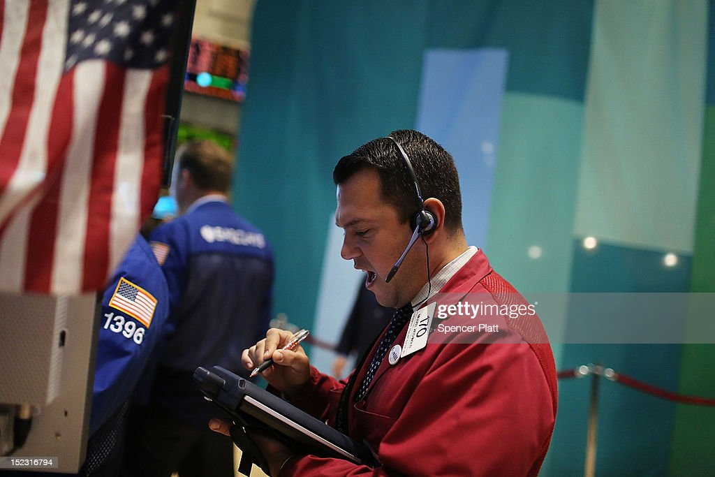 Traders work on the floor of the New York Stock Exchange as Central Intelligence Agency Director David Petraeus rings the Morning Bell as the CIA Commemorates it's 65th Anniversary on September 18, 2012 in New York City. Stocks fell in early trading as investors continued to be concerned about Europe and the global economy.