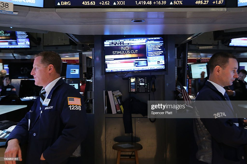 Traders work on the floor of the New York Stock Exchange as it is announced the Federal Reserve will not alter the stumulis program on September 18, 2013 in New York City. As the economic outlook continues to remain precarious for the central bank, the Federal Reserve announced that it will continue its bond-buying program in full for at least another month. News of the decision sent stocks soaring with the Dow Jones industrial average up over 160 points in afternoon trading.