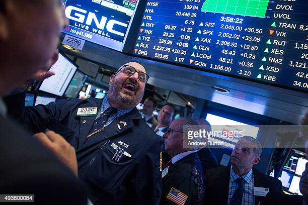 Traders work on the floor of the New York Stock Exchange as the stock price for GNC Holdings is reopened during the afternoon of October 22 2015 in...