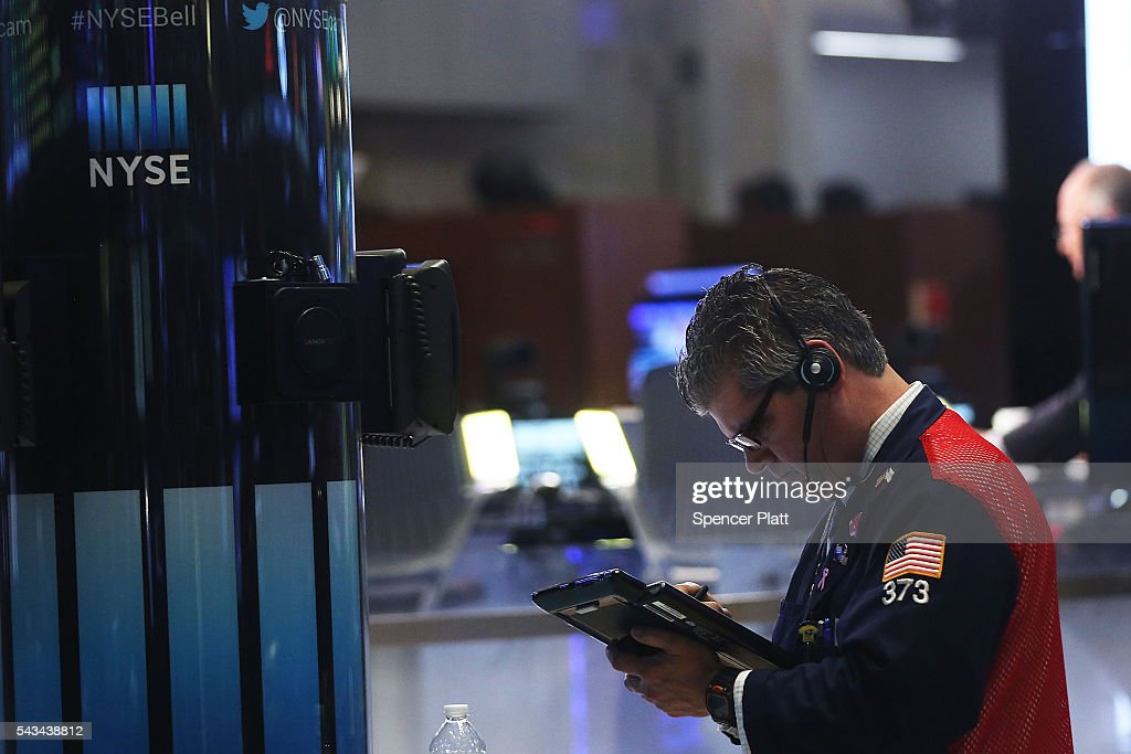 Traders work on the floor of the New York Stock Exchange (NYSE) at the close of the trading day on June 28, 2016 in New York City. Following days of market turbulence due to Britain's vote to separate from the European Union, markets bounced back today with the Dow Jones industrial average rising over 200 points.