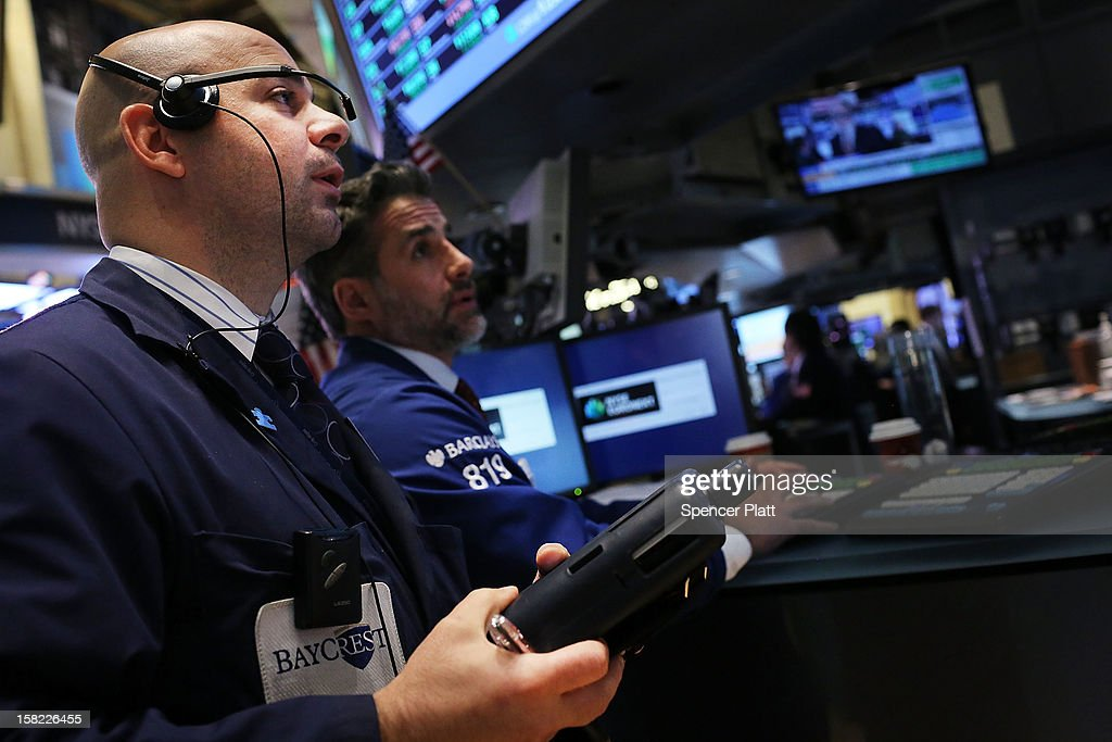 Traders work on the floor of the New York Stock Exchange at the end of the day on December 11, 2012 in New York City. With expectations that the Federal Reserve may announce more stimulus measures by the end of the year, the U.S. Stock Market moved higher Tuesday. The Dow Jones industrial average rose 0.6 percent with the the S&P 500 rising 0.65 percent.