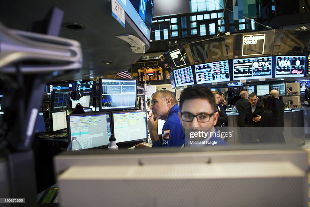 Traders work on the floor of the New York Stock Exchange at the end of the trading day on February 4, 2013 in New York City. Stocks dropped sharply February 4, to 13,880 after the Dow closes last week above 14000.