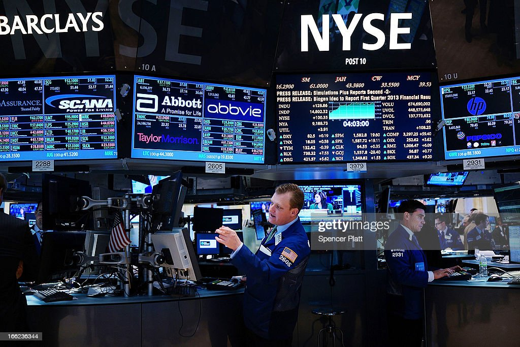 Traders work on the floor of the New York Stock Exchange at the end of the trading day on April 10, 2013 in New York City. The Dow Jones industrial average hit a new trading high of 14,826.66 Wednesday, moving up 0.9%.