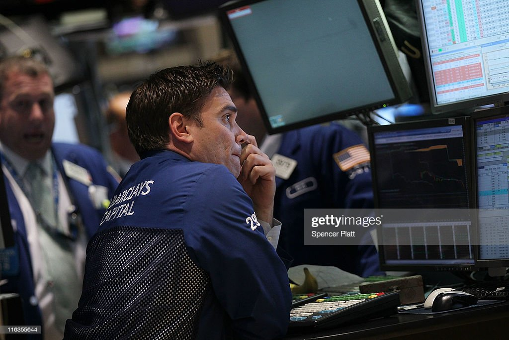 Traders work on the floor of the New York Stock Exchange before the close on June 15, 2011 in New York City. Reversing much of the previous day's gains, stocks fell Wednesday as more news emerged about the fragility of the American and global economy. The Dow Jones Industrial Average fell 88 points, or 0.8%, to 11987 in morning trading