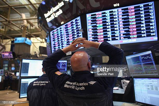 Traders work on the floor of the New York Stock Exchange before the closing bell on November 1 2011 in New York City US stocks and global markets...