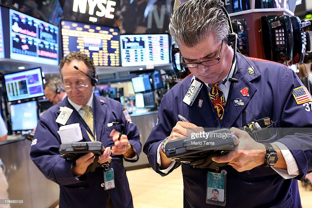 Traders work on the floor of the New York Stock Exchange before the closing bell on August 15, 2013 in New York City. Stocks dropped on weak earnings as the Dow fell 225 points to close at 15,112.19.