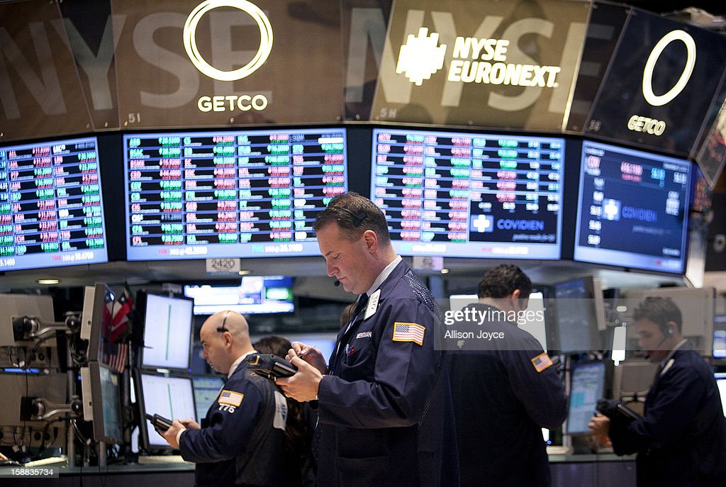 Traders work on the floor of the New York Stock Exchange December 31, 2012 in New York City. US lawmakers are struggling to work out a last-minute deal to avoid the 'fiscal cliff,' which could mean tax raises for millions of Americans.