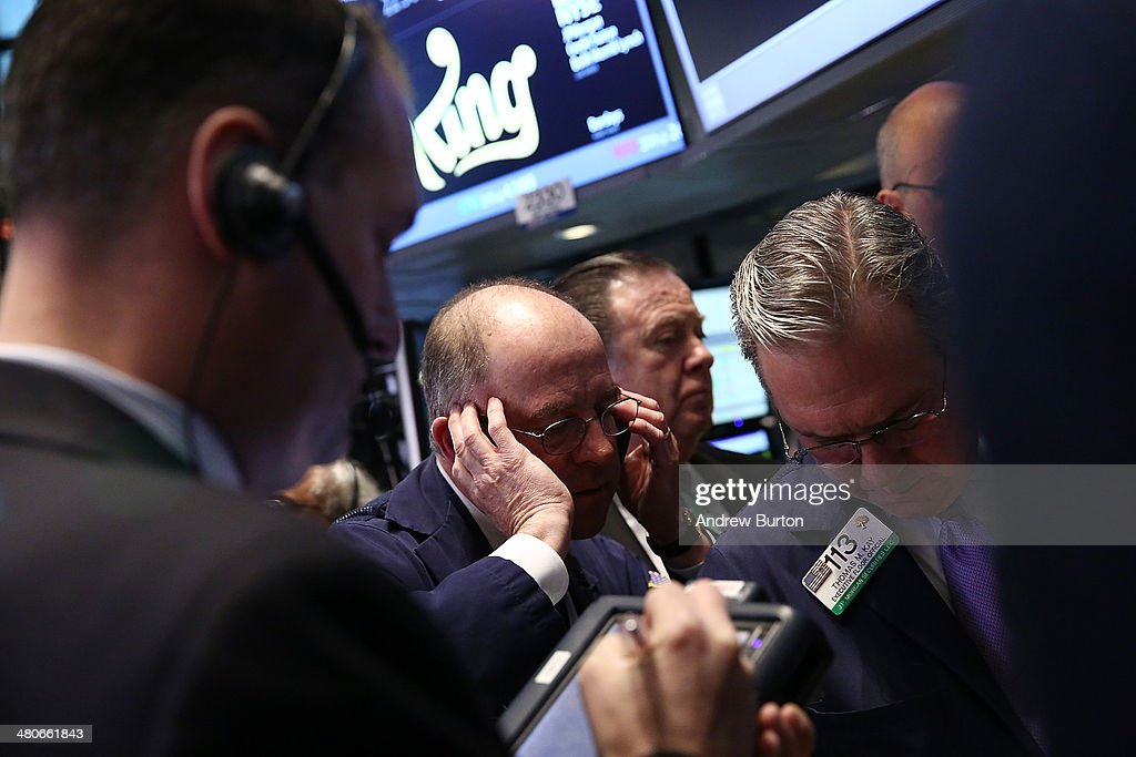 Traders work on the floor of the New York Stock Exchange during King's initial public offering on March 26, 2014 in New York City. King is the maker of the popular mobile game Candy Crush.