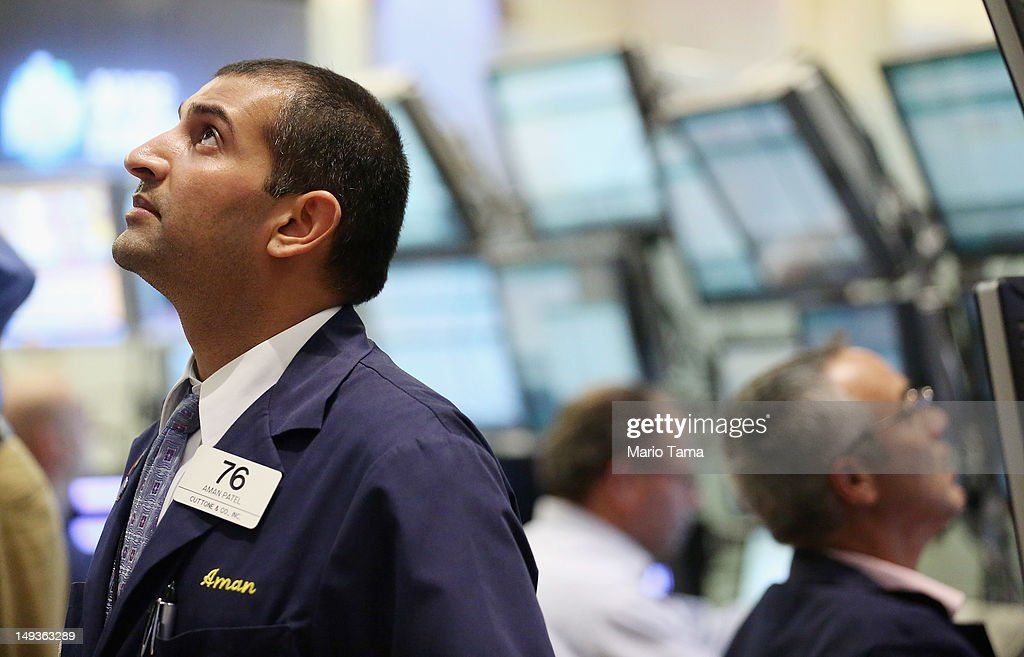 Traders work on the floor of the New York Stock Exchange during afternoon trading on July 27, 2012 in New York City. The Dow finished above 13,000 for the first time since May to close at 13,075.66 on hopes that European and American central banks will further assist the global economy.