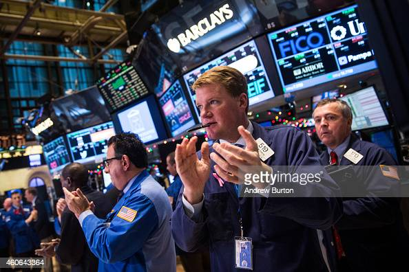 Traders work on the floor of the New York Stock Exchange during the afternoon of December 18 2014 in New York City The stock market had its best day...