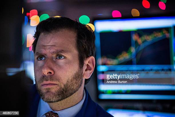 Traders work on the floor of the New York Stock Exchange during the afternoon of December 23 2014 in New York City The Dow Jones Industrial Average...